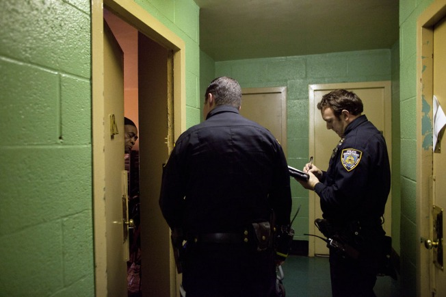 New York City police officers go door to door in a housing project to take note of which residents are ignoring the mandatory evacuation order as Hurricane Sandy approaches on October 28, 2012 in the Rockaway Beach neighborhood of the Queens borough of New York City. Photo: Allison Joyce, Getty Images