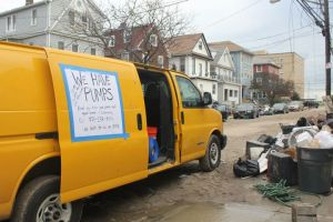 """A 15' cargo van with a """"giant sign on the side of the cargo van that said that we had pumps"""". Image by Respond & Rebuild."""