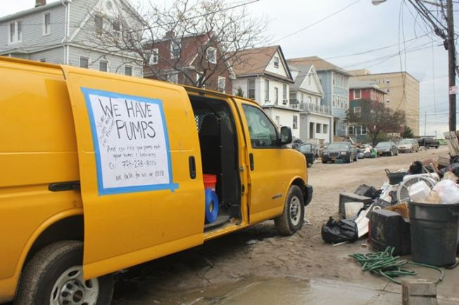 "A 15' cargo van with a ""giant sign on the side of the cargo van that said that we had pumps"". Image by Respond & Rebuild."