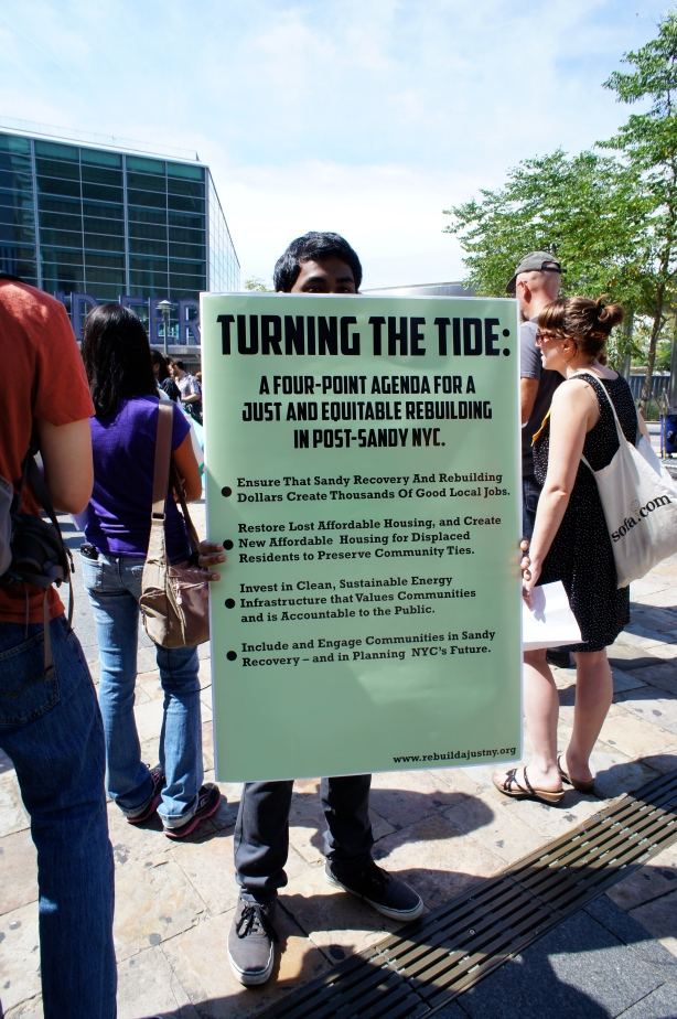 Placard outlining a just rebuilding in NYC as part of an earlier demonstration in the Turn the Tide campaign. Photograph by Max Liboiron.